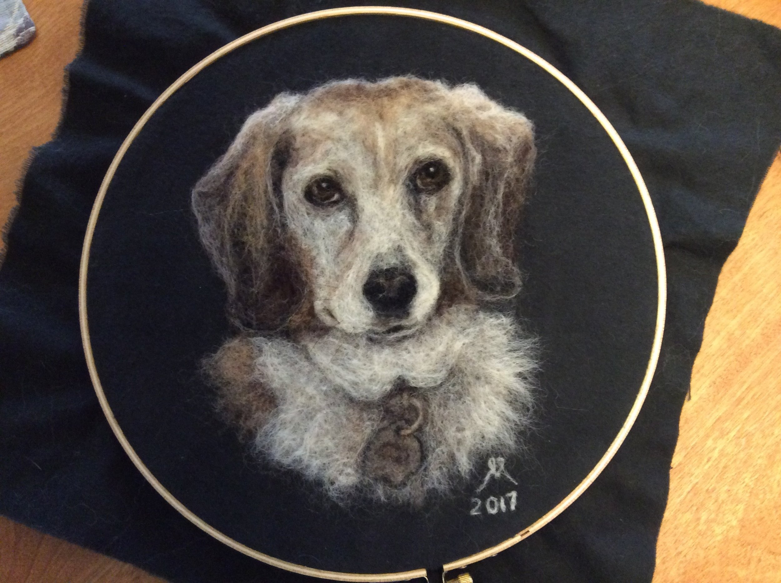 """""""Mia"""", Dec. 2017. Needle felted using wool, dog and cat hair onto black brushed cotton fabric. Commission: Sold."""
