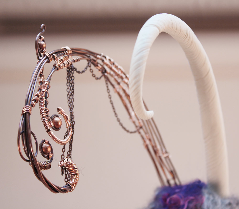 closeup of wire wrapped horn and clay horn