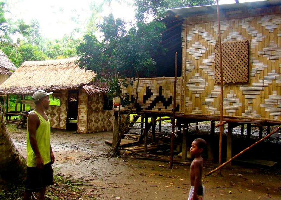 The hut on the right is actually their home in the village and the hut on the left is their kitchen.