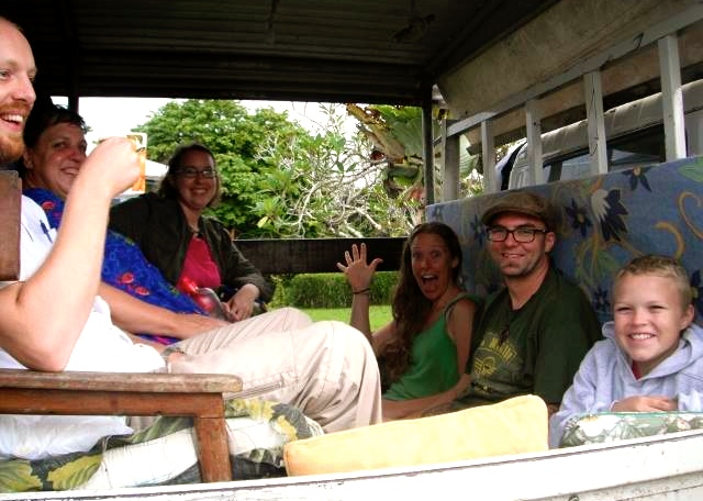 Stephanie, James, and Ethan in the truck on the way to their new home in Ukarumpa!