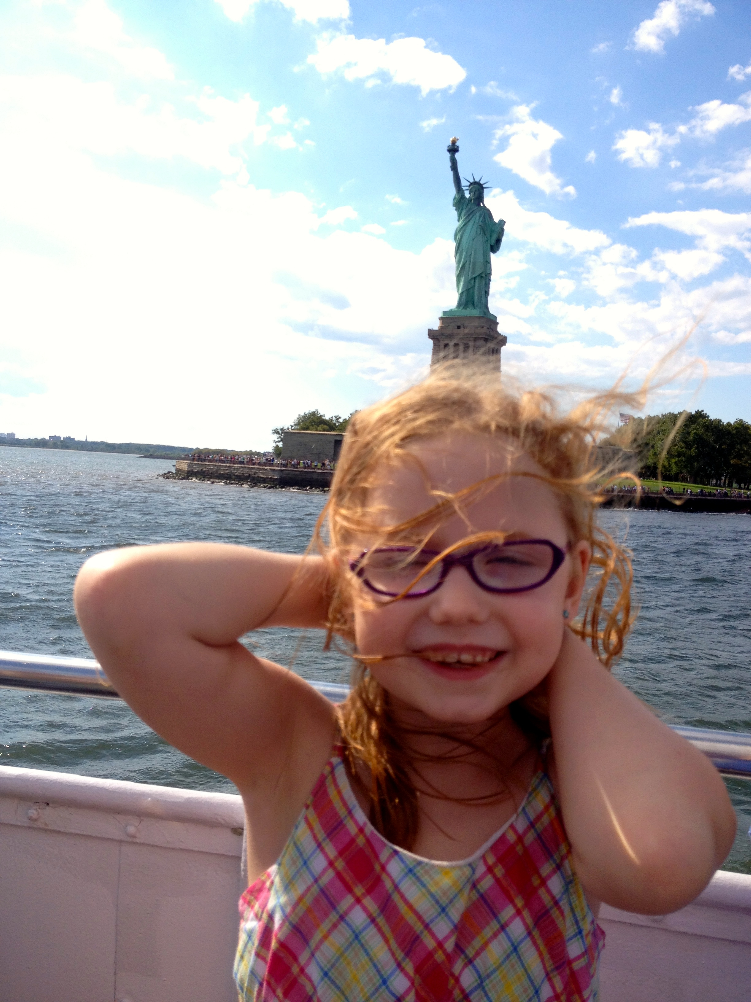 John thought it was great fun to try to get photos with Lady Liberty on people's heads.