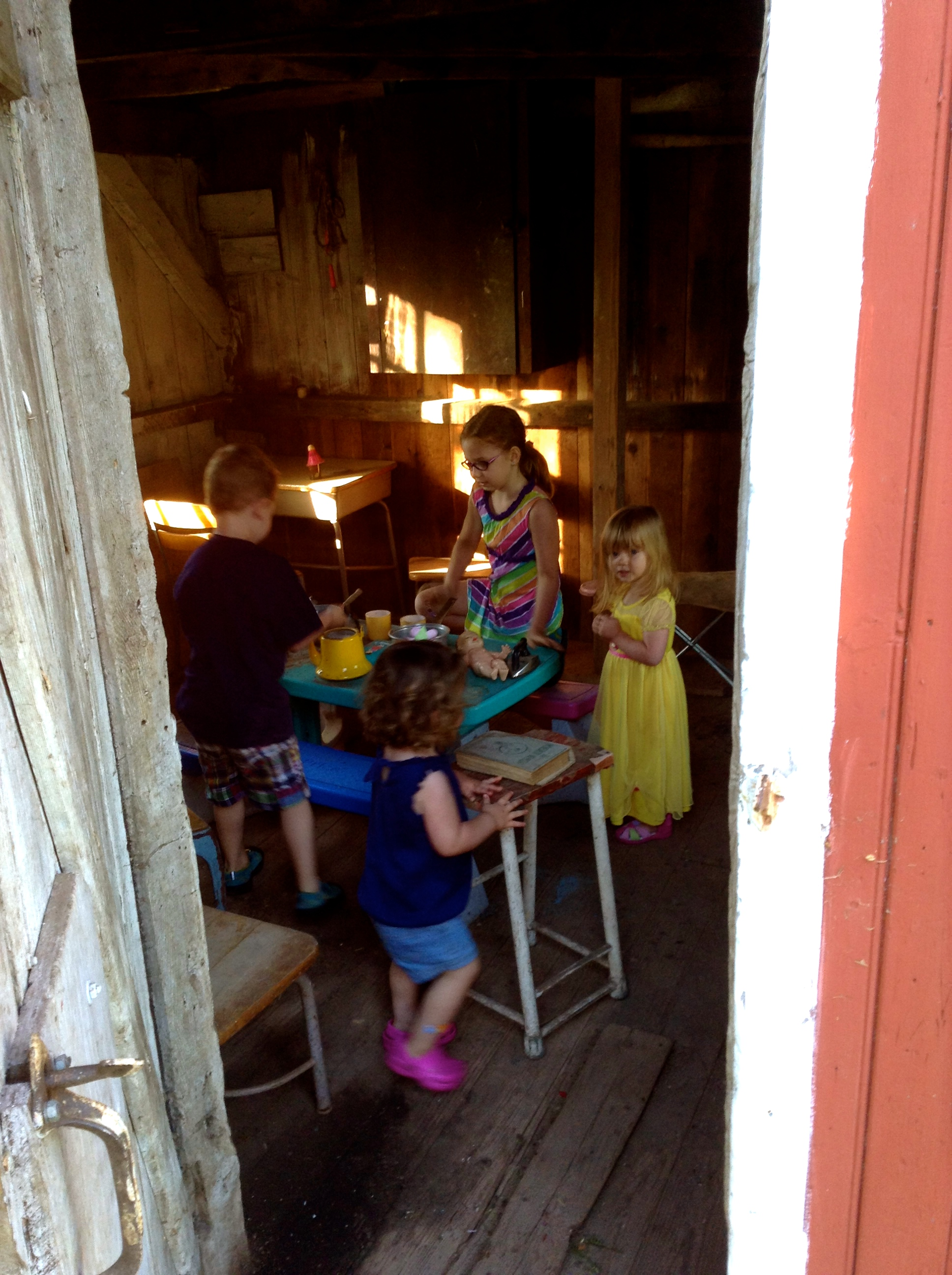 A school house play room on the farm. Playing with our new friend, sweet little Caroline.