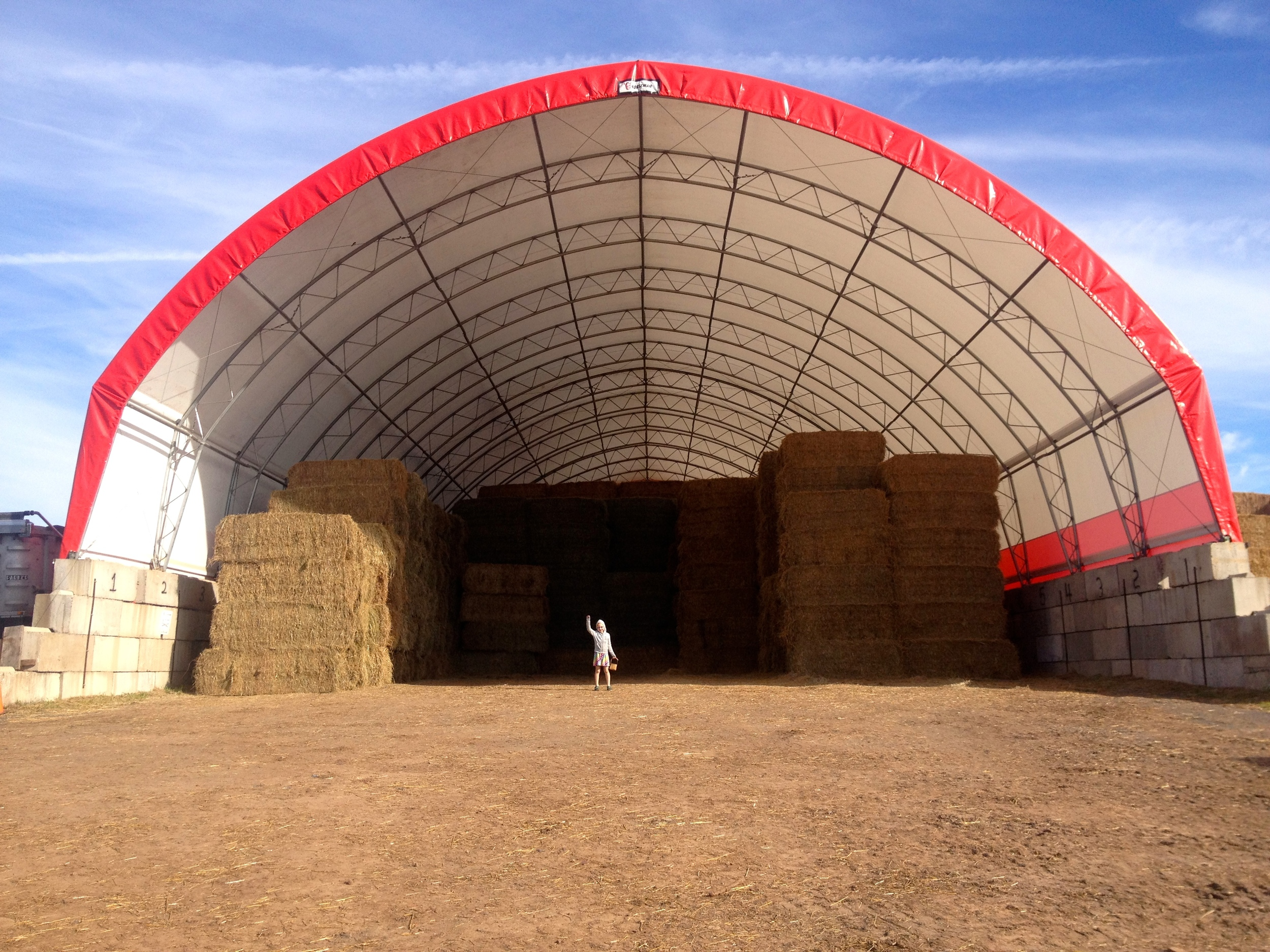 Here is ONE of the hay stacks... that wee little figure in the middle is Nori.