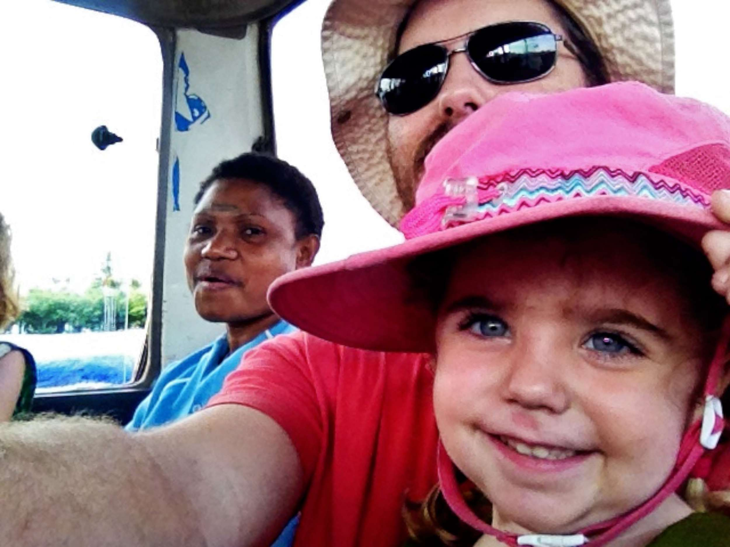 Riding in the back of a PMV with Auntie Suzanne.