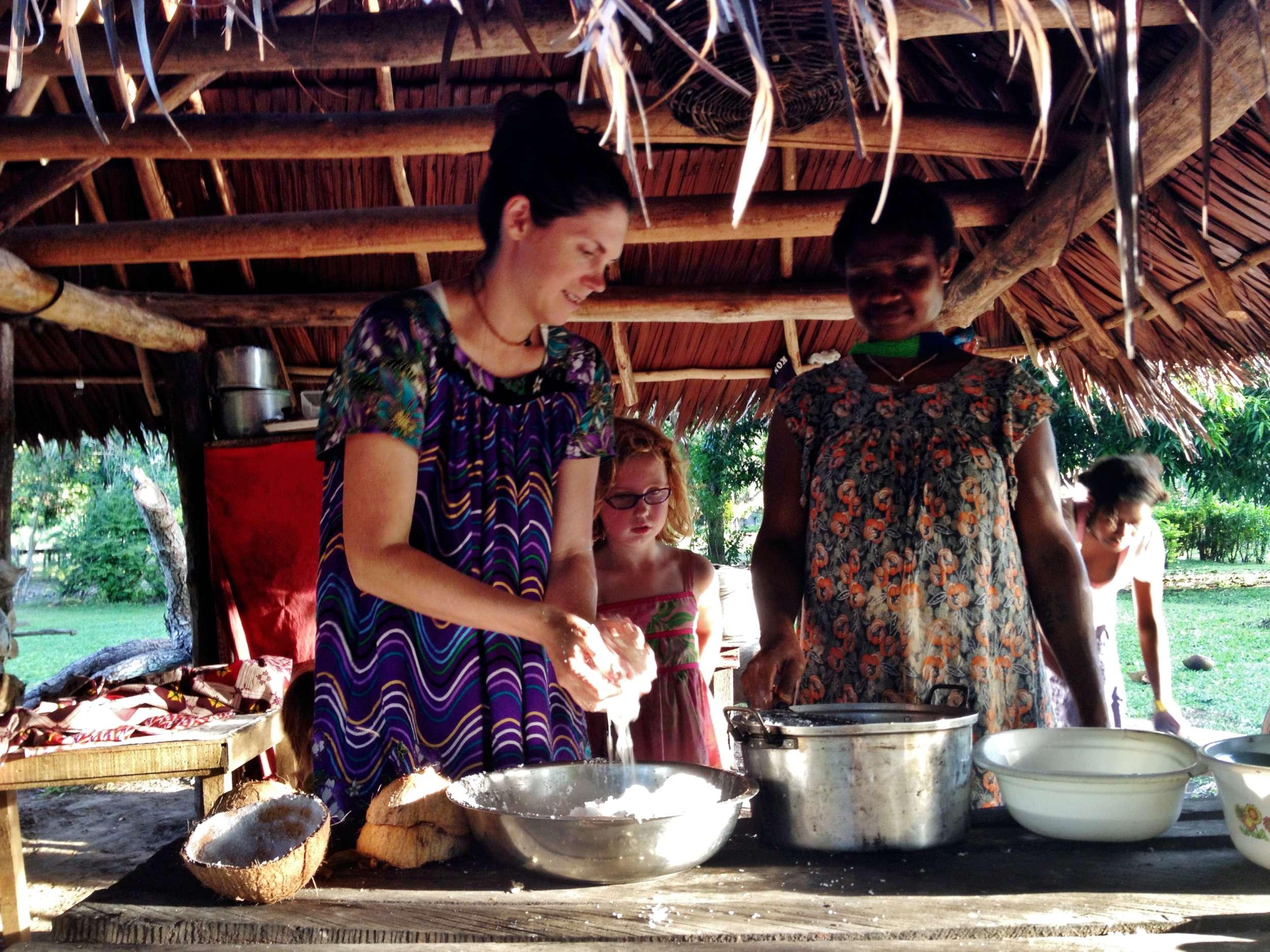 Kristi greasing coconuts.