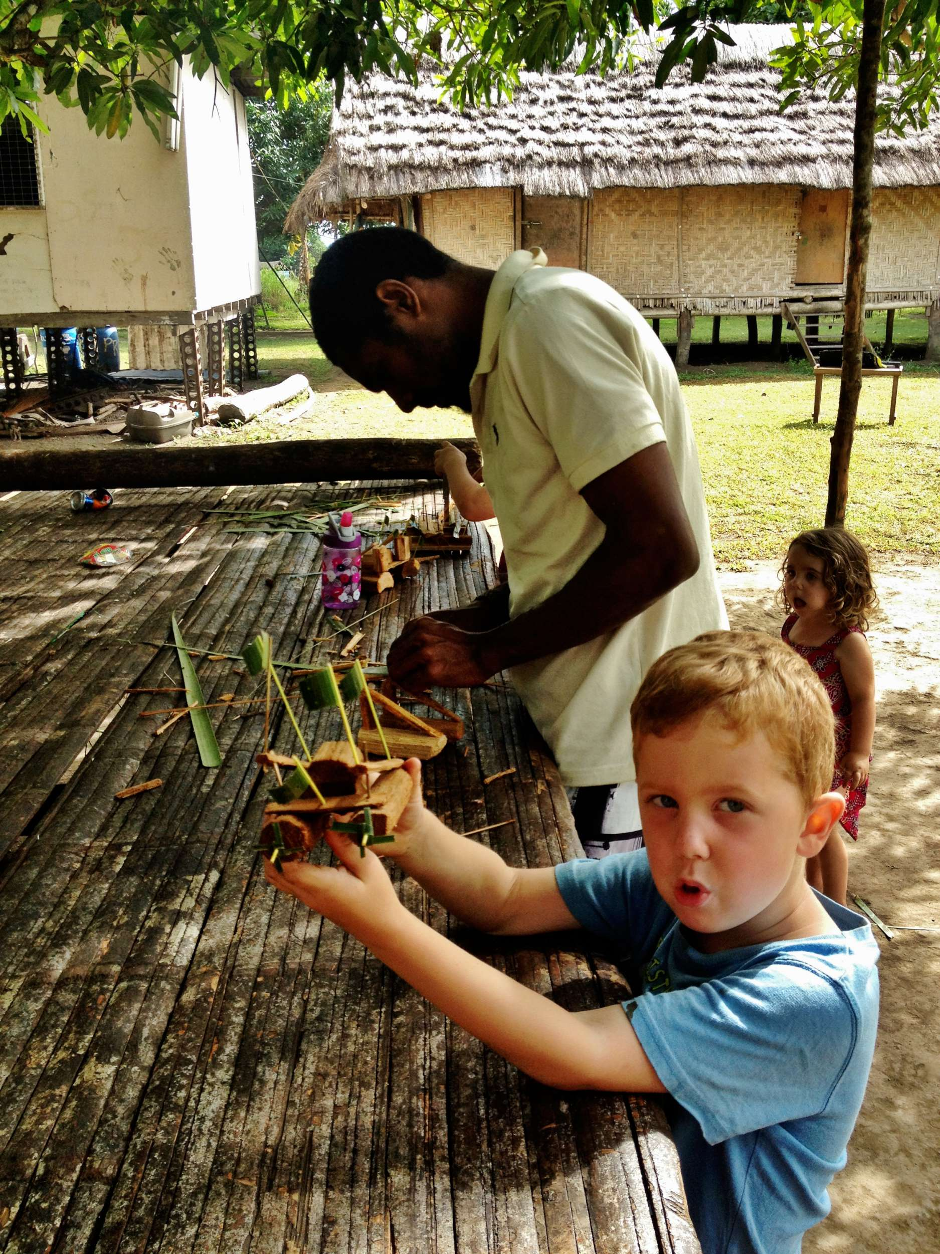 Michael's skills were many, and these boats made from Sago palms were an instant hit.