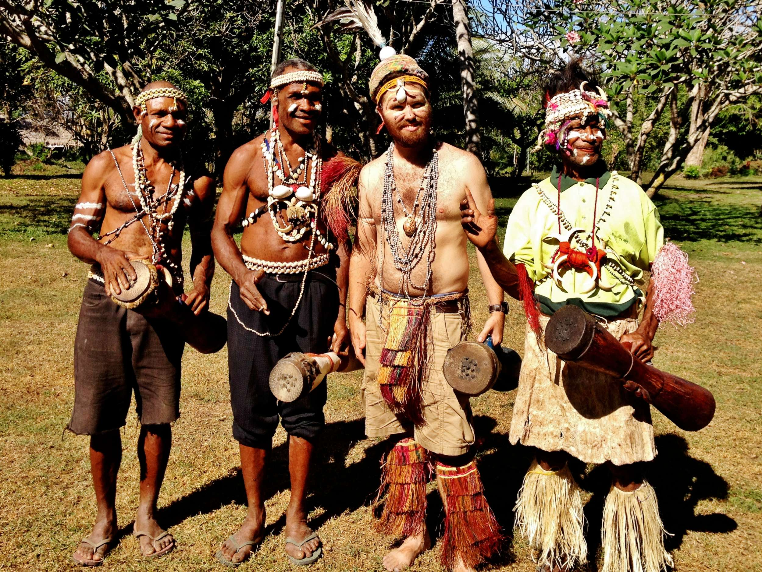 """John with Jerry (his """"brata"""" or brother), and withNalauand Mattias (Papa's nephews). All with kundus in hand."""