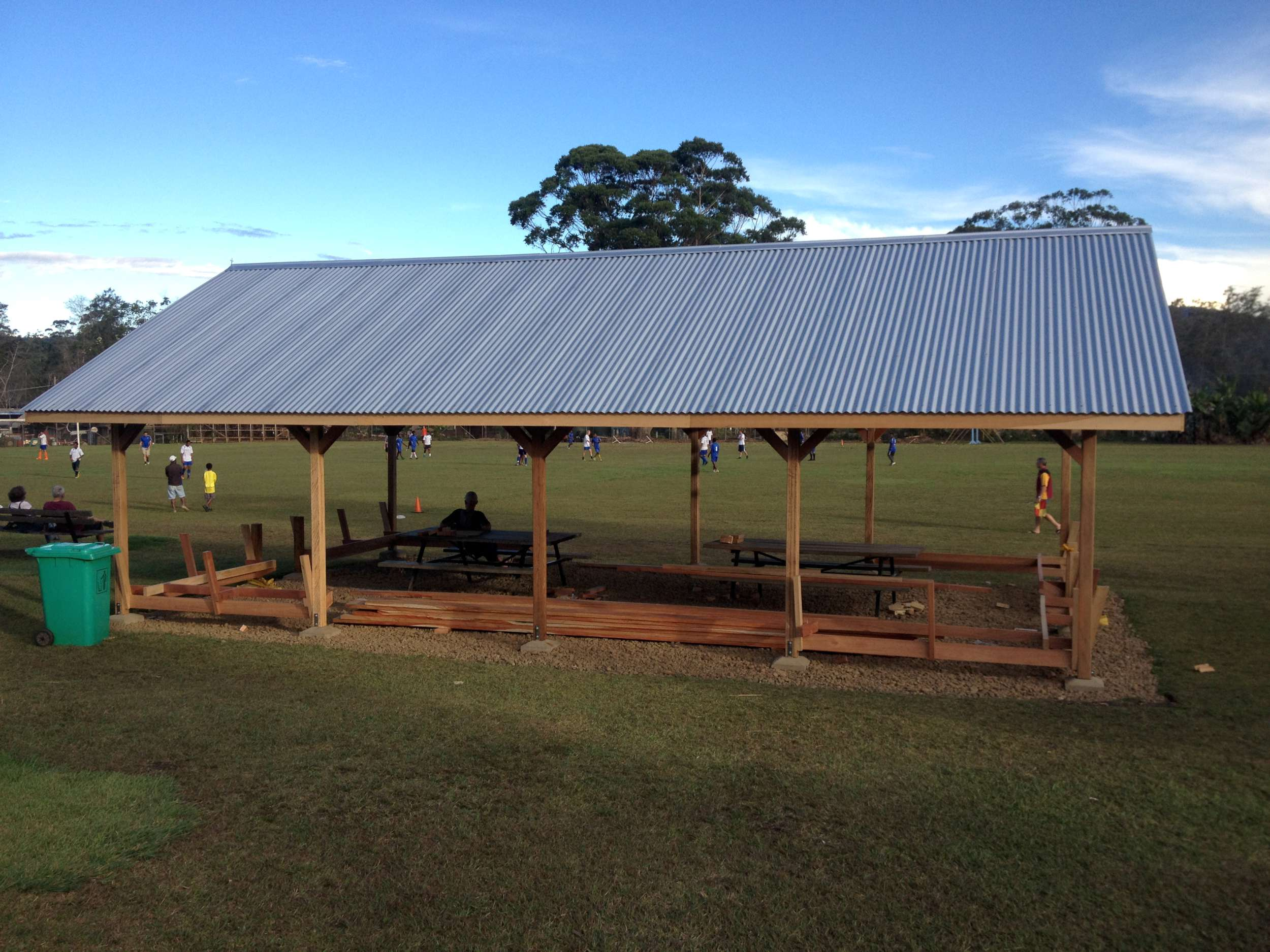 "I got to design and build this  hauswin  (think ""House Wind"") with my CAM guys which resides at the high school. The schools here in Ukarumpa allow hundreds of Bible translators to continue their work as their kids reach school ages. We built benches into the perimeter of this hauswin so that it would serve as a hub for community on campus."
