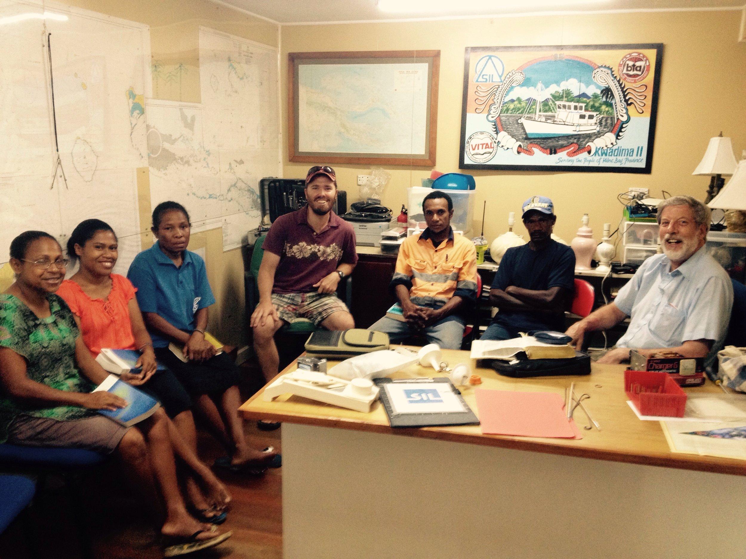 From left: Dora, Kelly, Susan, John, Mathew, Samson, and Joe in the Alotau Regional Center office.