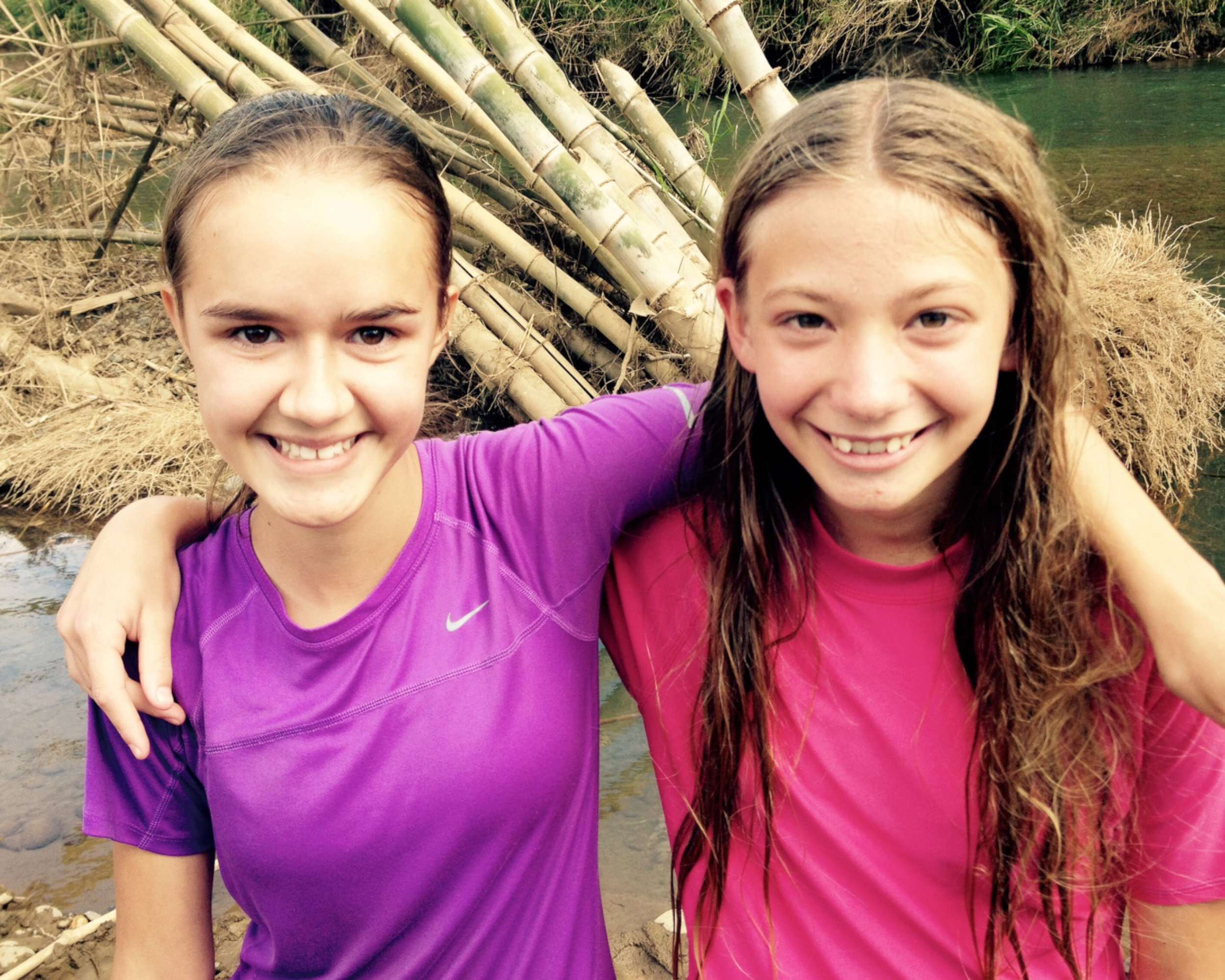Two of Kristi's 7th-grade girls that were baptized in the river!