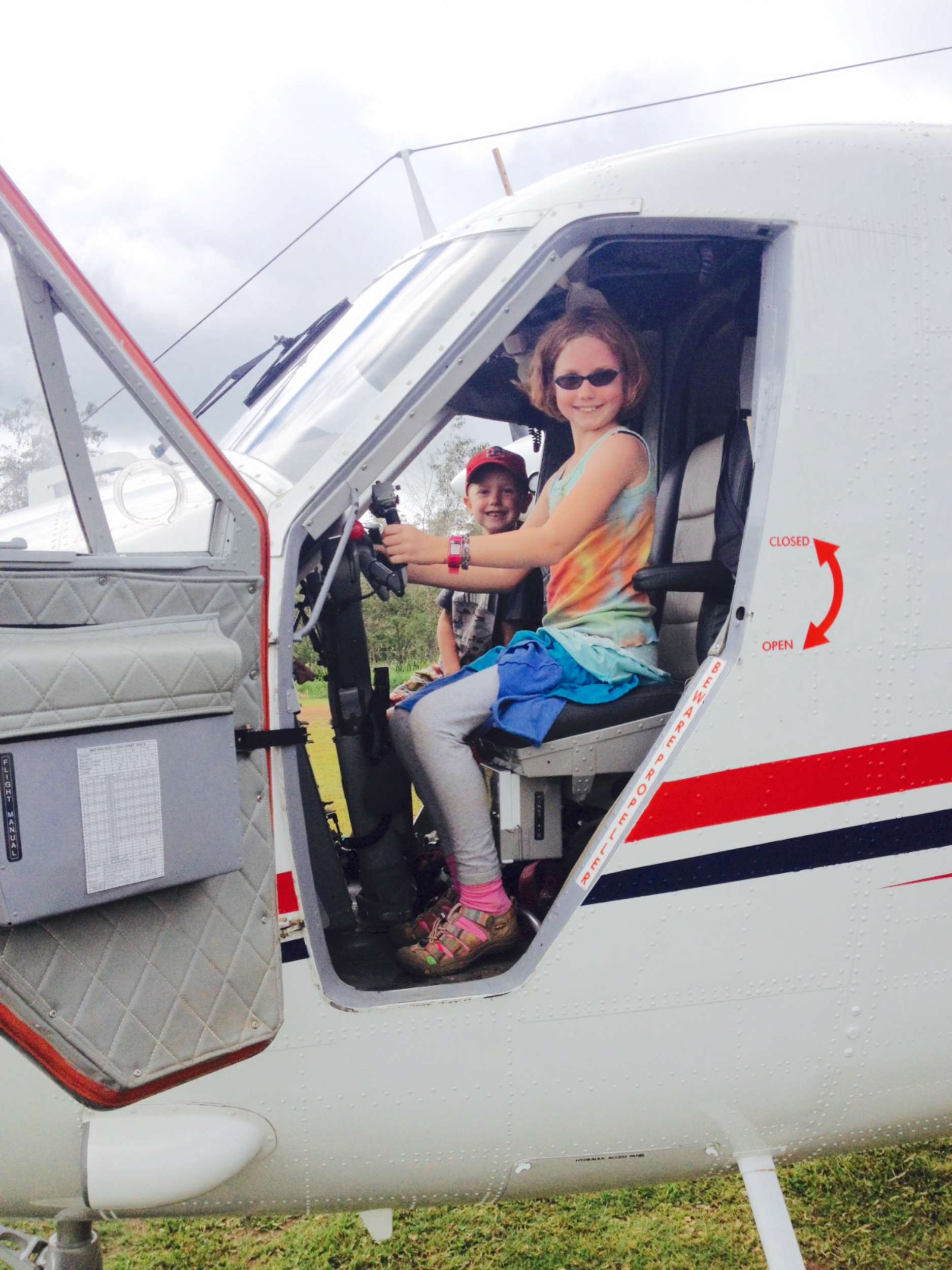 Nori and Banner came to help me help move another person relocating from the Sepik province on the Queen's Birthday (a big thing here...). In any case, Aviation was closed, but the MAF pilots that showed up let the kids check out the Twin Otter.
