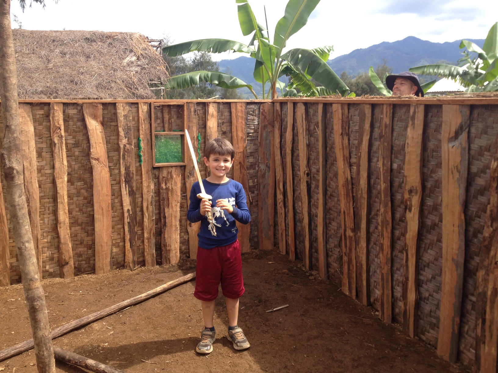 Adam's son explores inside a house that their pastor is building; Tony peeks in.