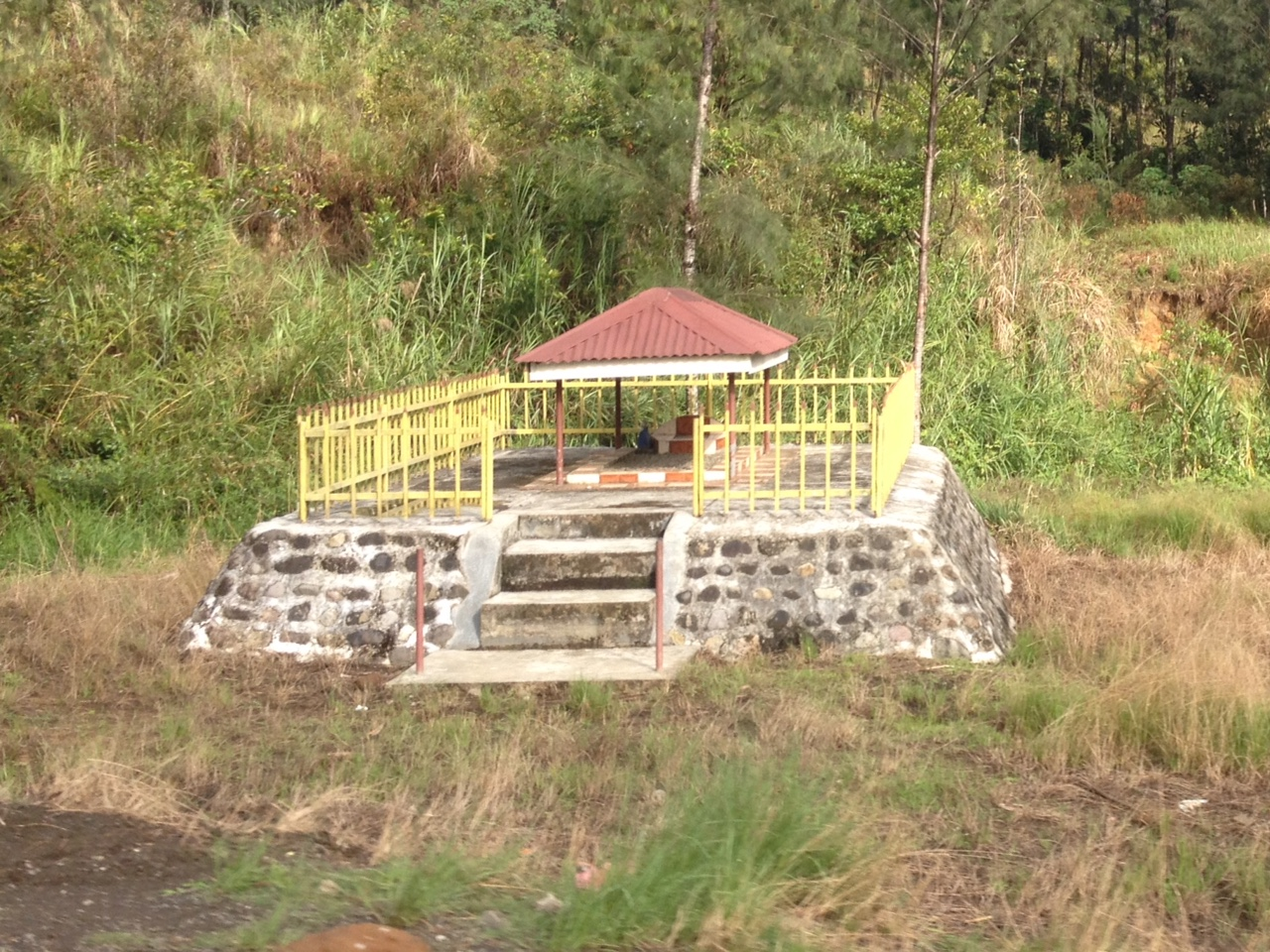 Individual graves like this one are common sights along the roadside. Some traditional beliefs include ancestors' spirits coming back and causing trouble if they aren't happy, so building them a nice home makes good sense.
