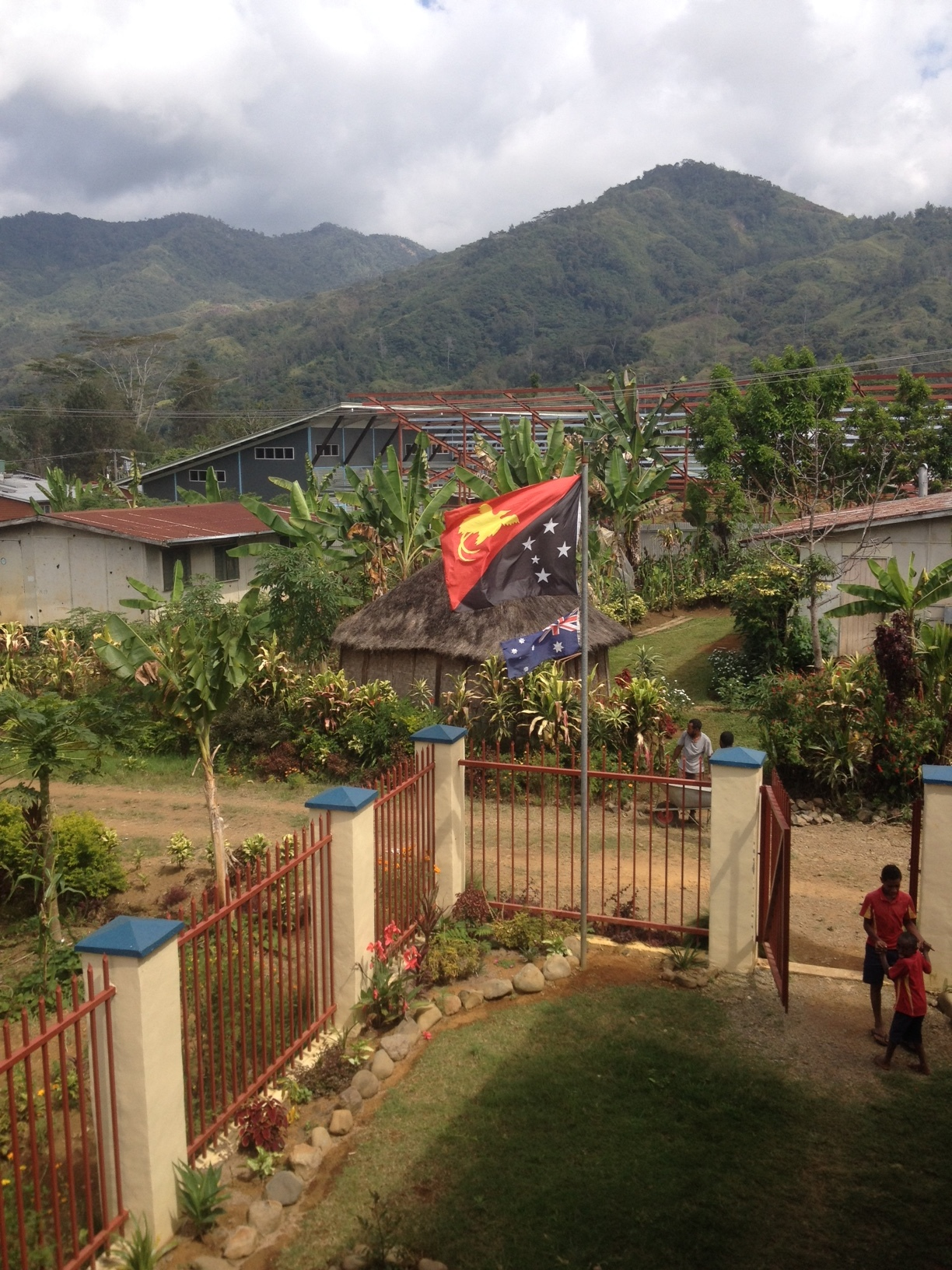 From the school stairway, looking back toward the hospital, with the PNG flag blowing.