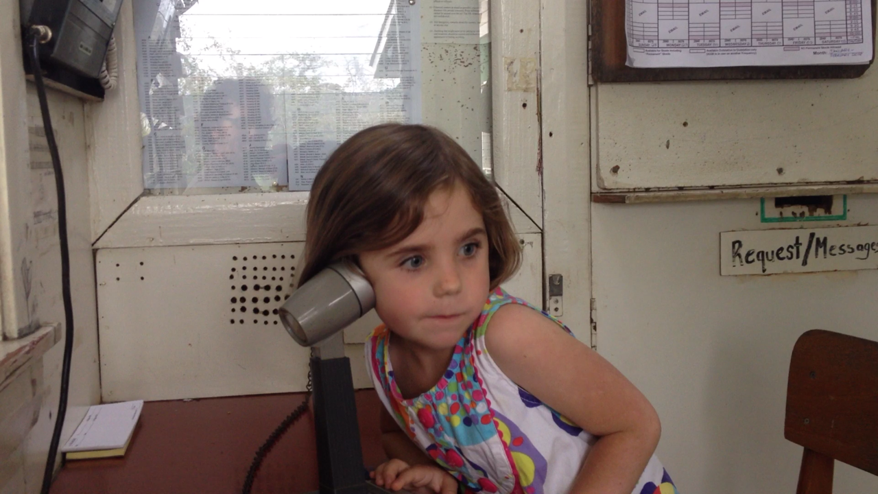 ...Millie talking on the radio with the Wade kids who are working in their village in East New Britain