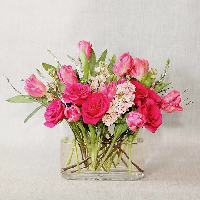 Fancy tulips and hot pink roses bring about that 'first kiss' bliss!