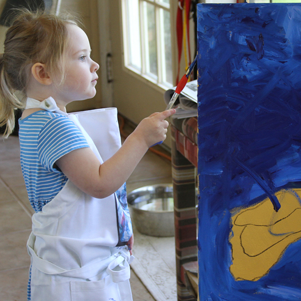 Lady L age Two Painting Flowers