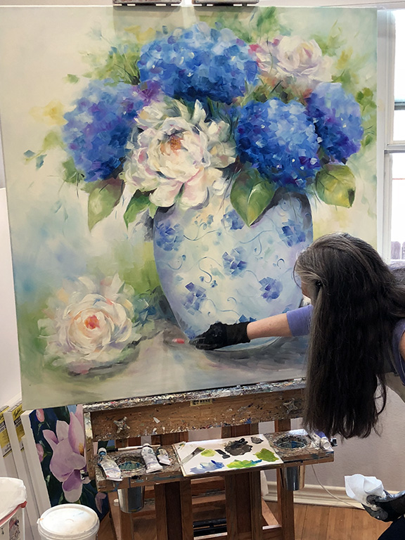White Peonies and Blue Hydrangea bloom in the studio of Laurie Pace.jpg