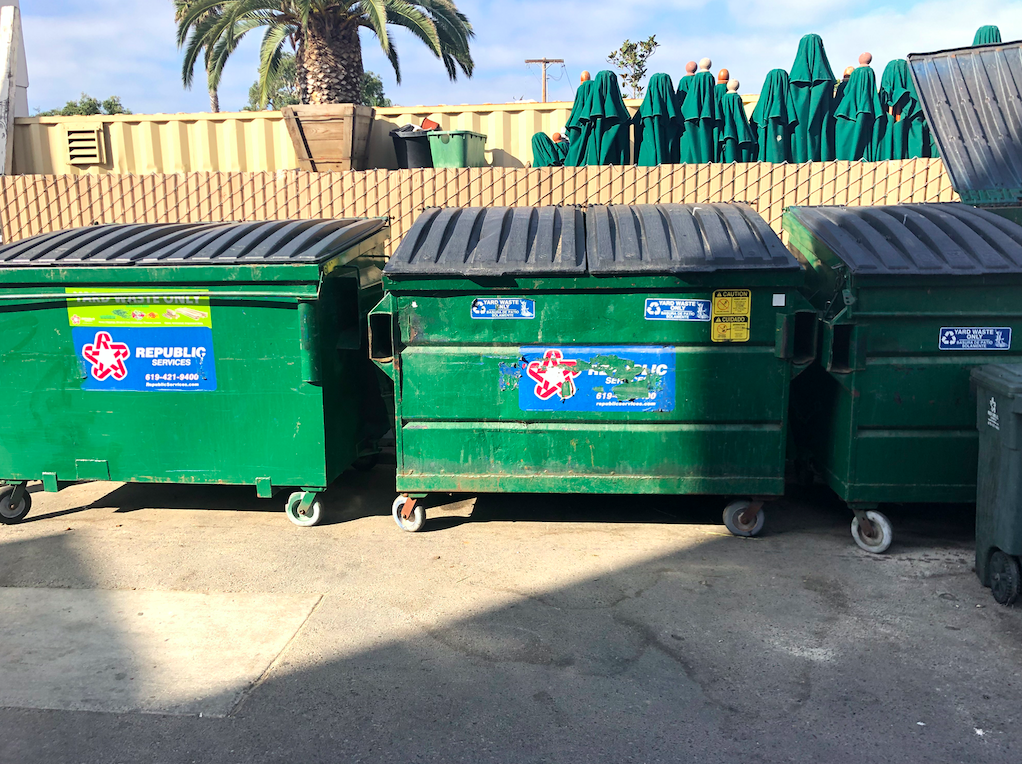 Three dumpsters, all different