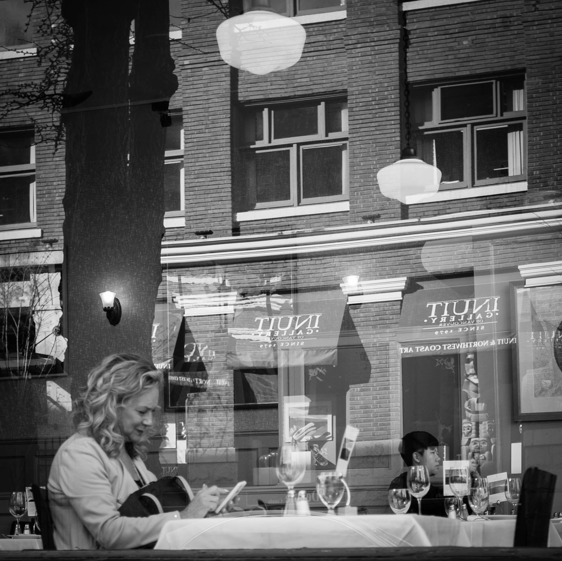 Woman in window with reflections Gastown, Vancouver Fuji X100T 3.16