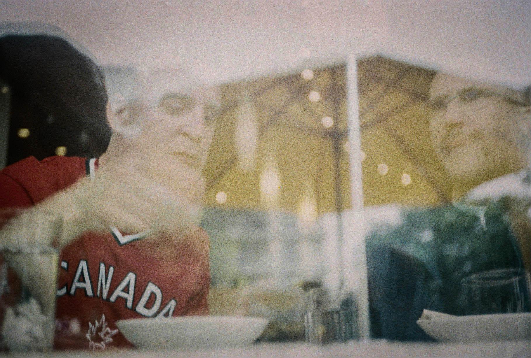 Men eating lunch in window Vancouver Rollei FX35 Fujicolor 400 film 7.16