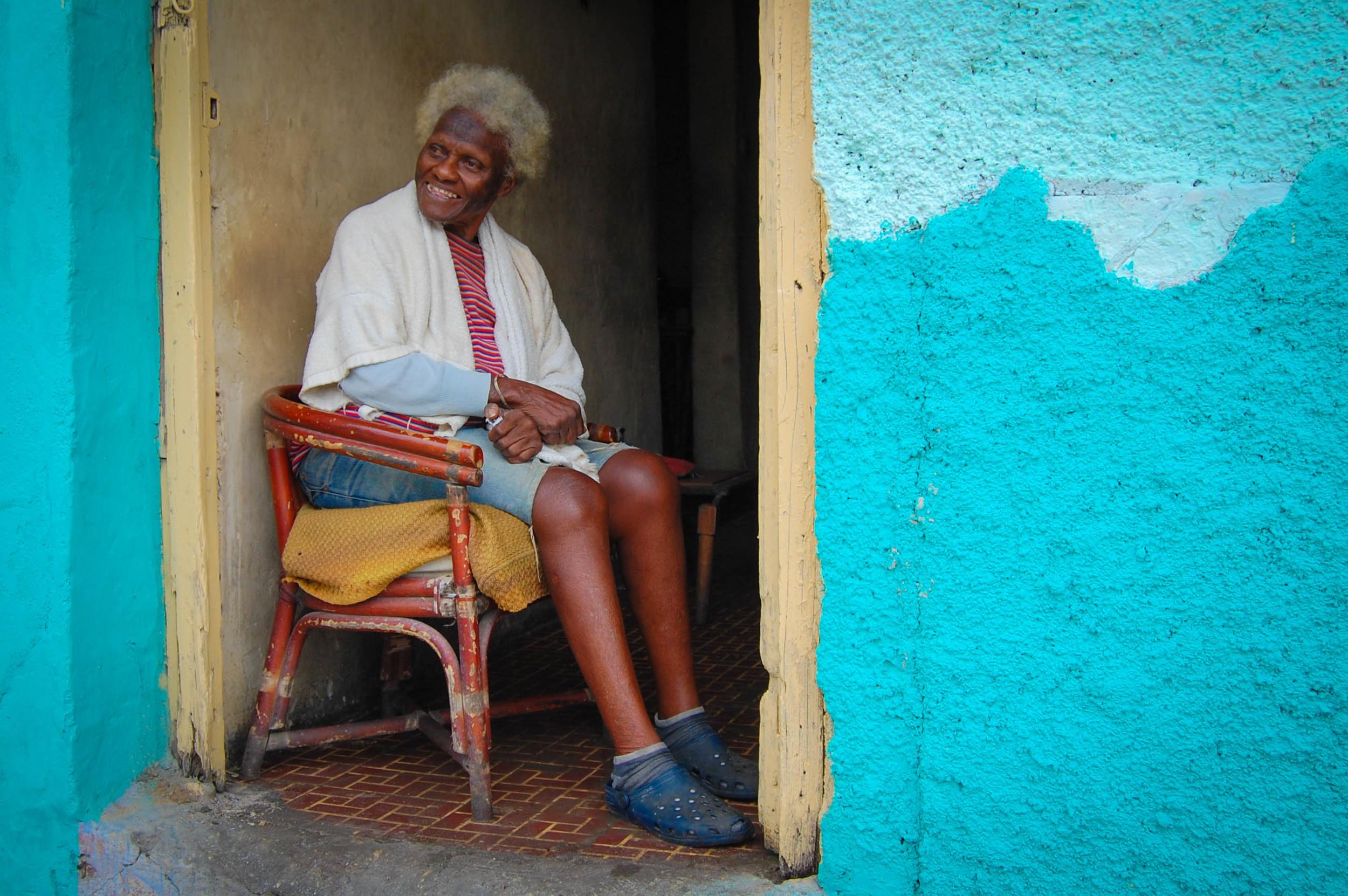 Woman in doorway Varadero, Cuba Nikon D40, 18-55 F3.5 3.13
