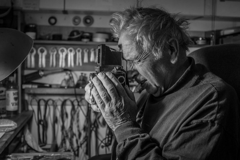 "Horst Wenzel checks out my Rolleiflex 2.8C. ""It's in pretty good shape,"" is his conclusion.    Fuji X100T 9.16"