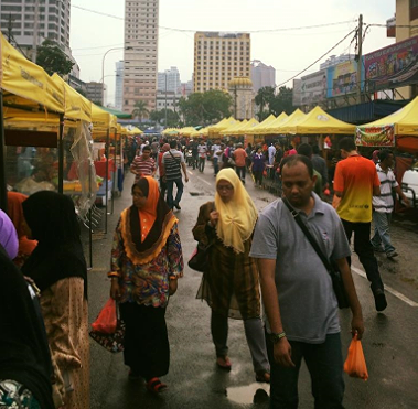 Even torrential downpours will    not    deter the hungry throngs or dedicated vendors