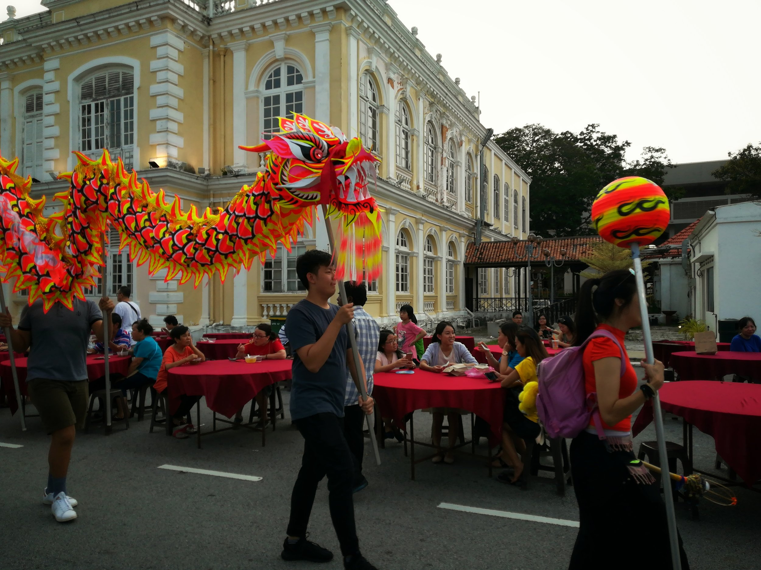 The good luck dragon visiting every food stall