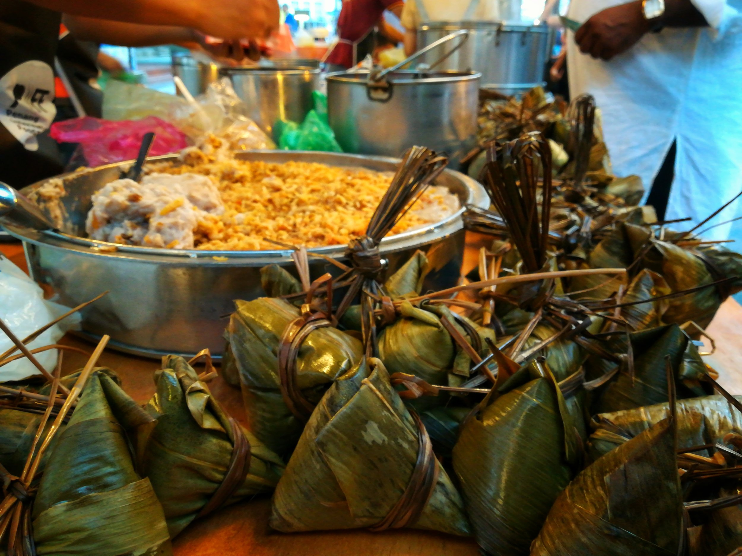 Bak Chang/Lo Mai Kai or Zongzi: The Bak Chang (which is what we call it in Penang) has a dizzying number of variations in South East Asia. In general, it is steamed glutinous rice wrapped with bamboo or banana leaf. There's usually a filling of roasted or steamed pork, mushrooms and salted egg yolk. The Malays actually have a similar snack that uses glutinous rice but with a filling of palm sugar and shredded coconut. More than likely inspired by Chinese traders and the Straits Chinese community.