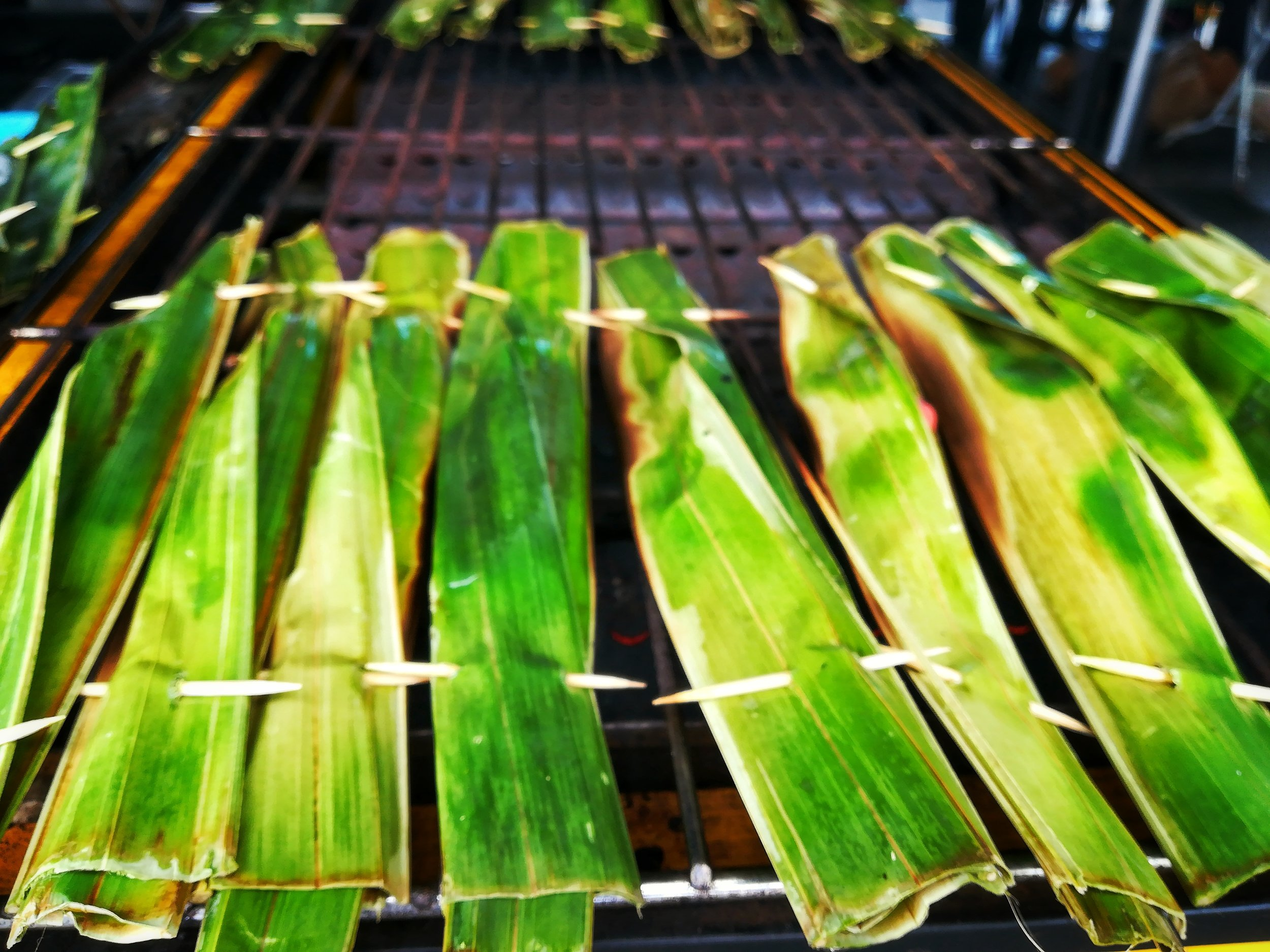 Otak otak is made with ground fish, spices, coconut milk and aromatics. It's either steamed or grilled, depending on where you're having it. The otak otak is a shared heritage recipe in the Nusantara region comprising Indonesia, Malaysia, Singapore and South Thailand.