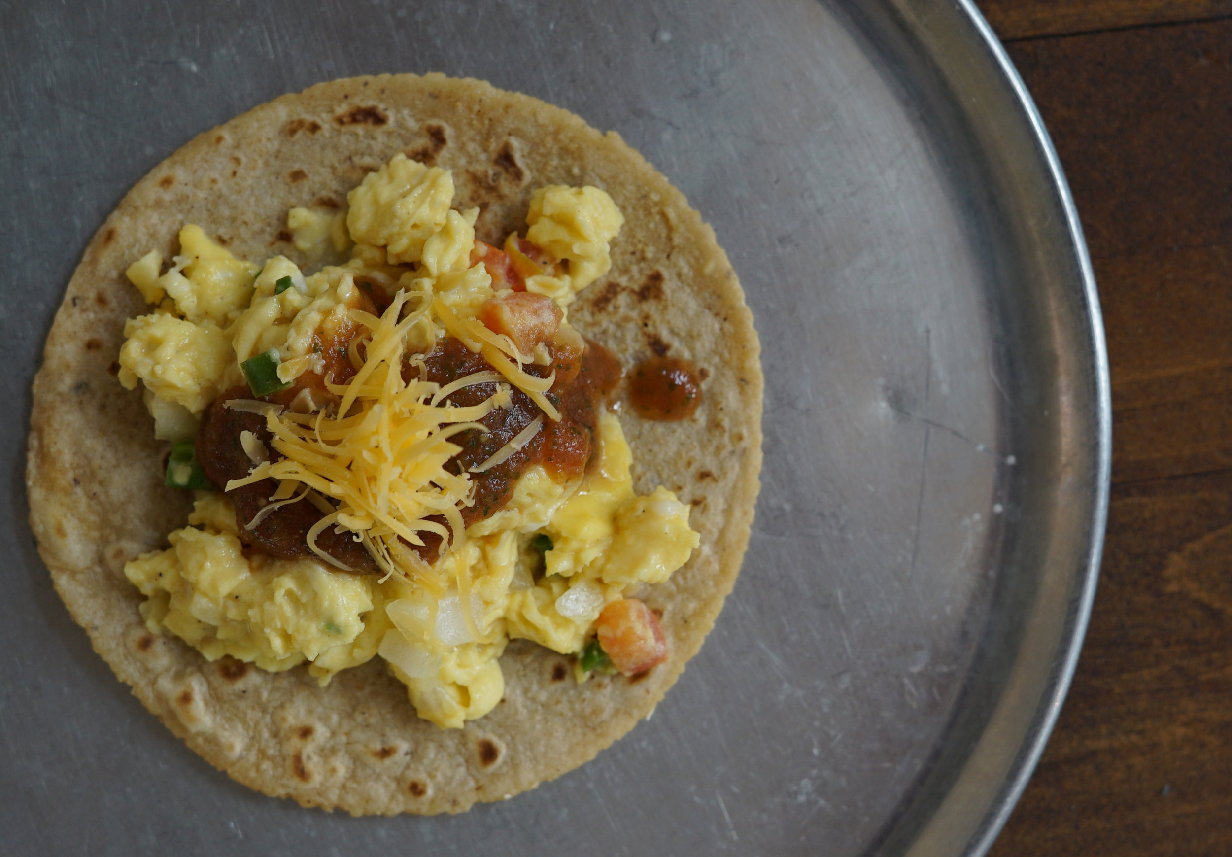 Mexicana  Diced tomato, onions and jalapeno scrambled with eggs and topped with salsa and queso amarillo.