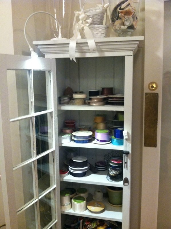 Both of these cabinets were hand made by a fellow who sells his furniture in antique markets across the country. I got them in Atlanta. The doors are old windows. I love things with a story.....I'm Southern. what can I say?