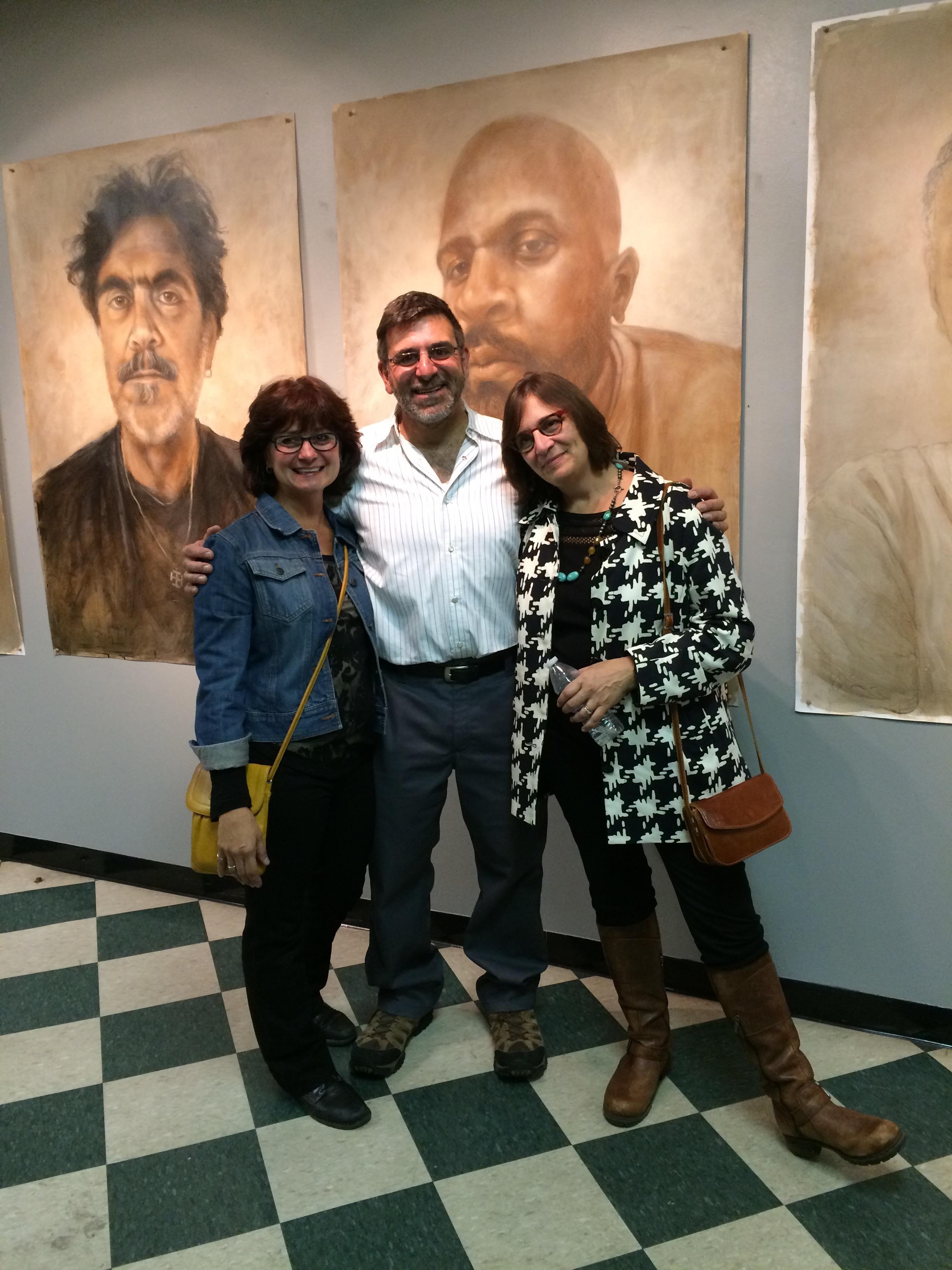 Joe Radoccia posing with sisters