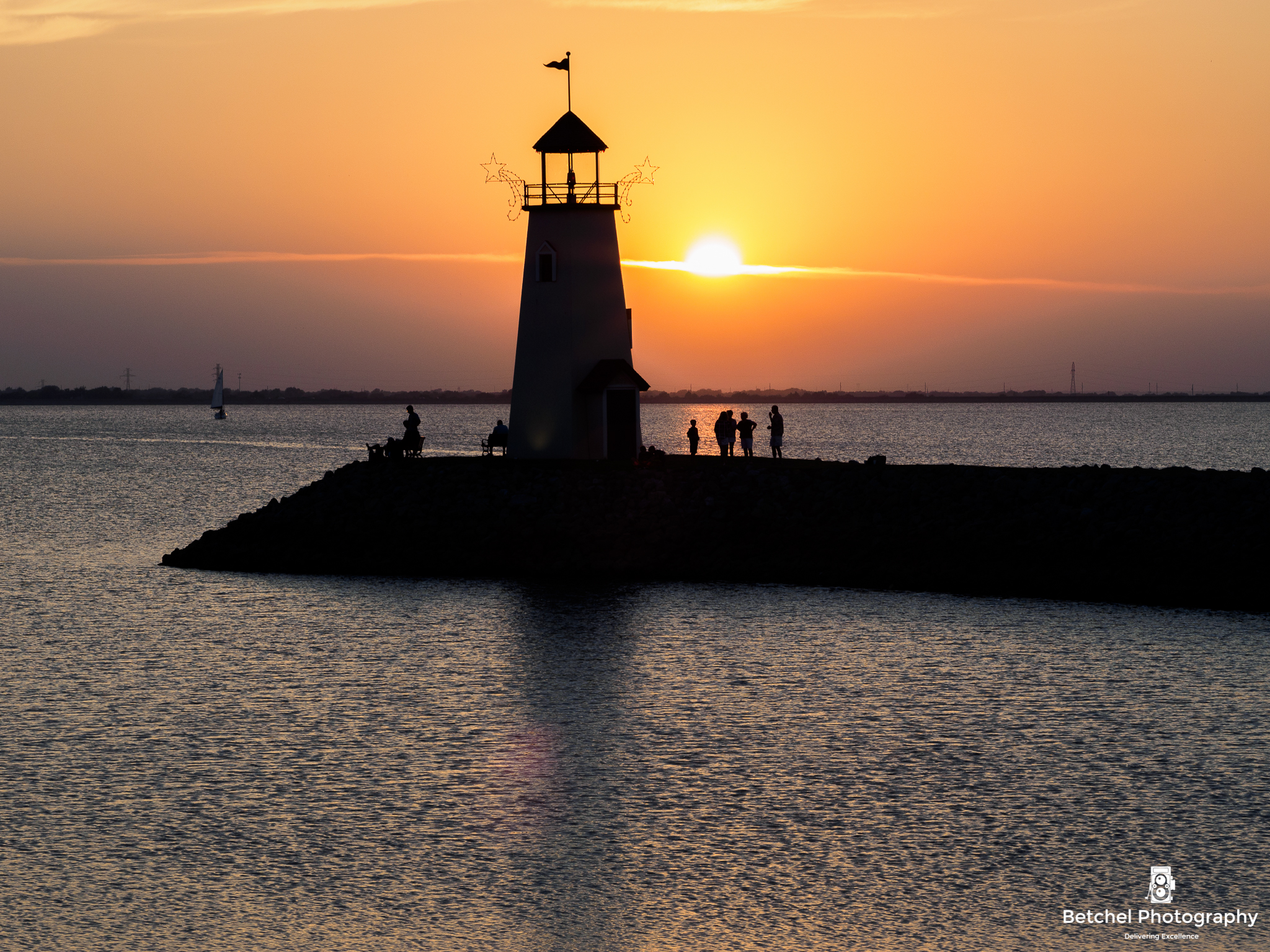 Lake Hefner lighthouse at sunset.  Photo by Betchel Photography of Edmond.