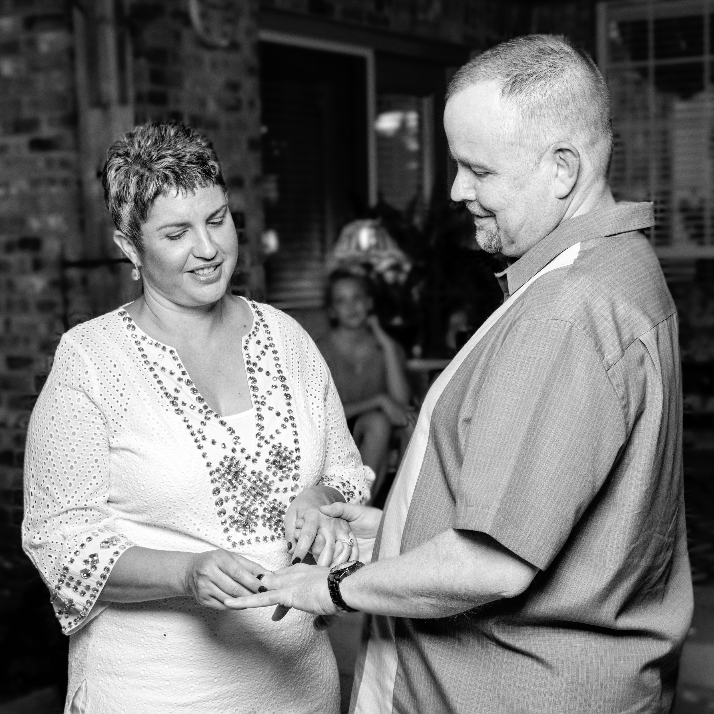 Exchanging of the rings.  Wedding Photography by Betchel Photography of Edmond.