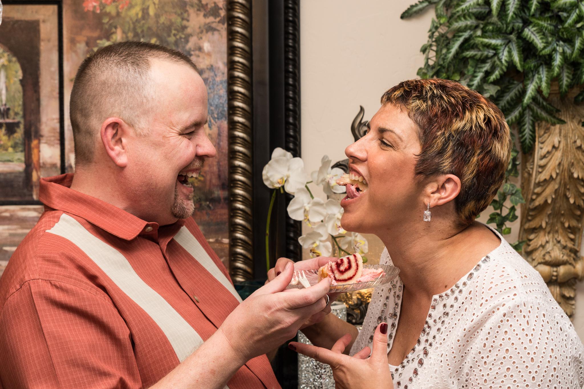 Enjoying the cake. Wedding Photography by Betchel Photography of Edmond.
