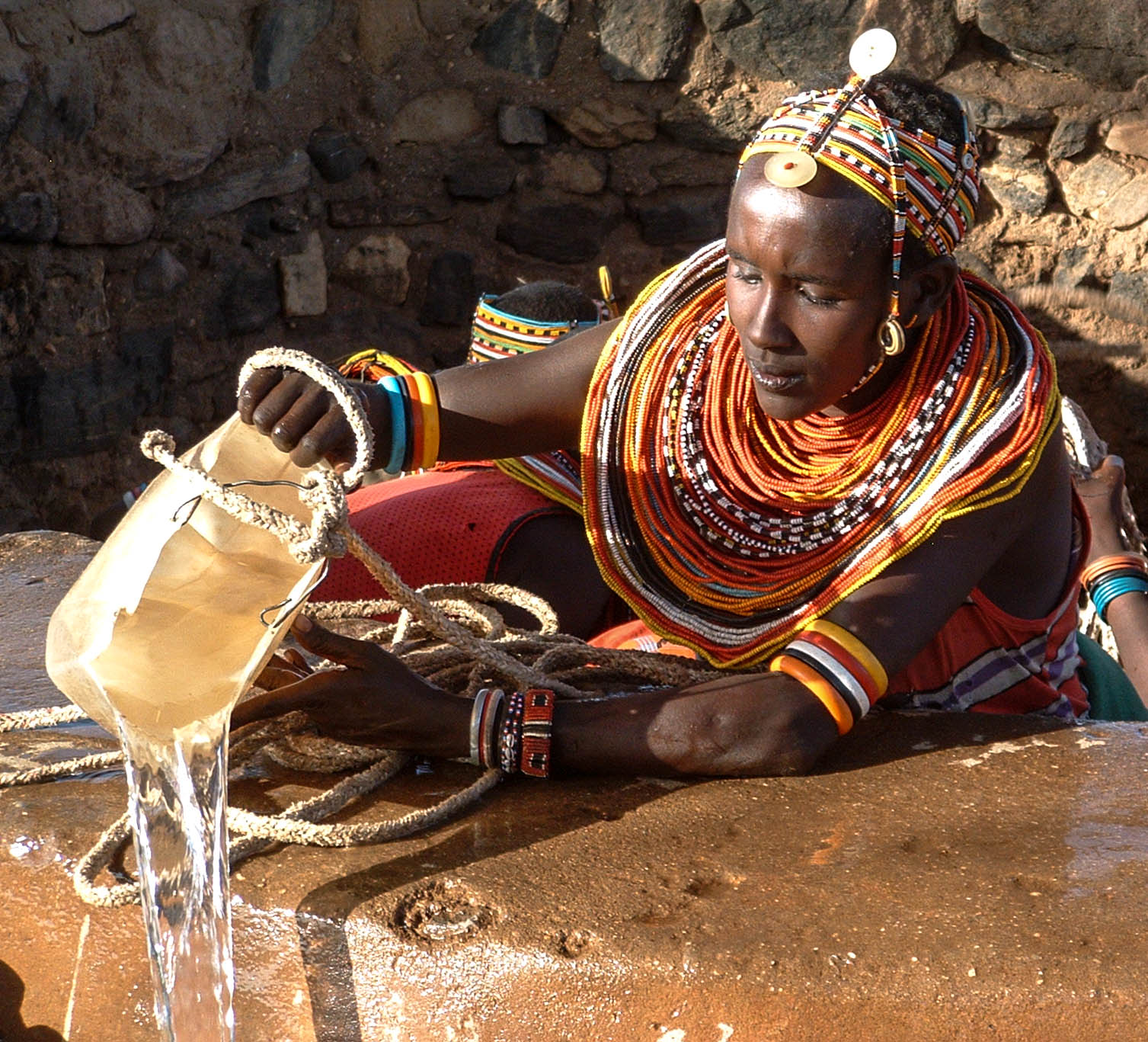 Hauling water from the hand-chisseled wells.jpg