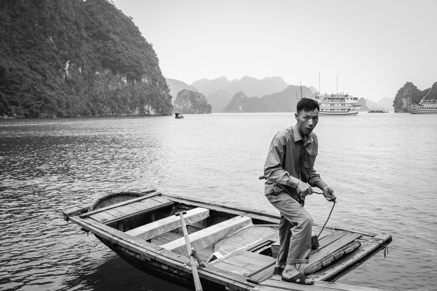 man on boat black and white.jpg
