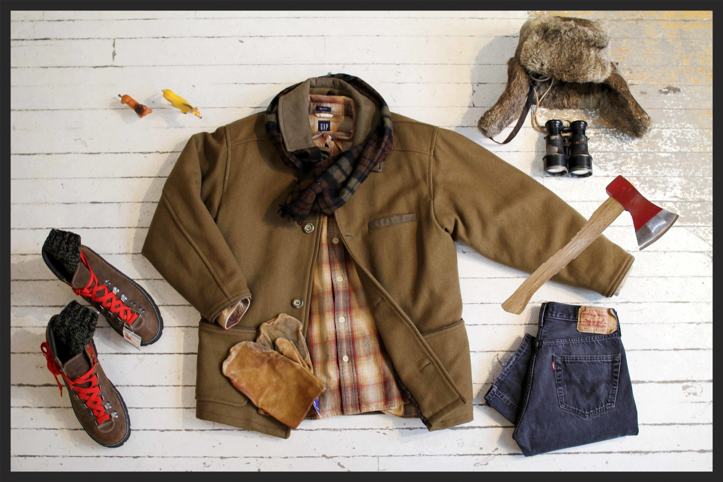 Coat: $69, flannel: $32, Levi's jeans: $52, boots: $52, mitts: $22, fur hat: $36, socks: $16, scarf: $24, toy animals: $3
