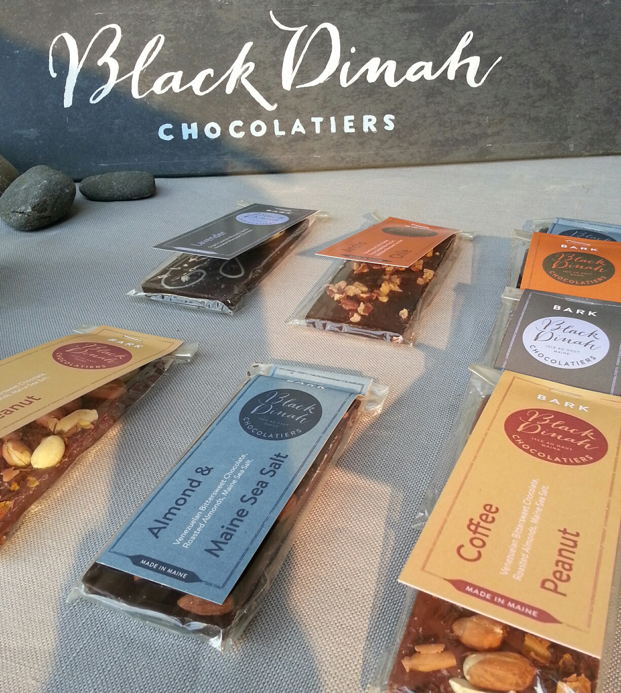 Close up of chocolate bark labels and painted slate sign for the booth.