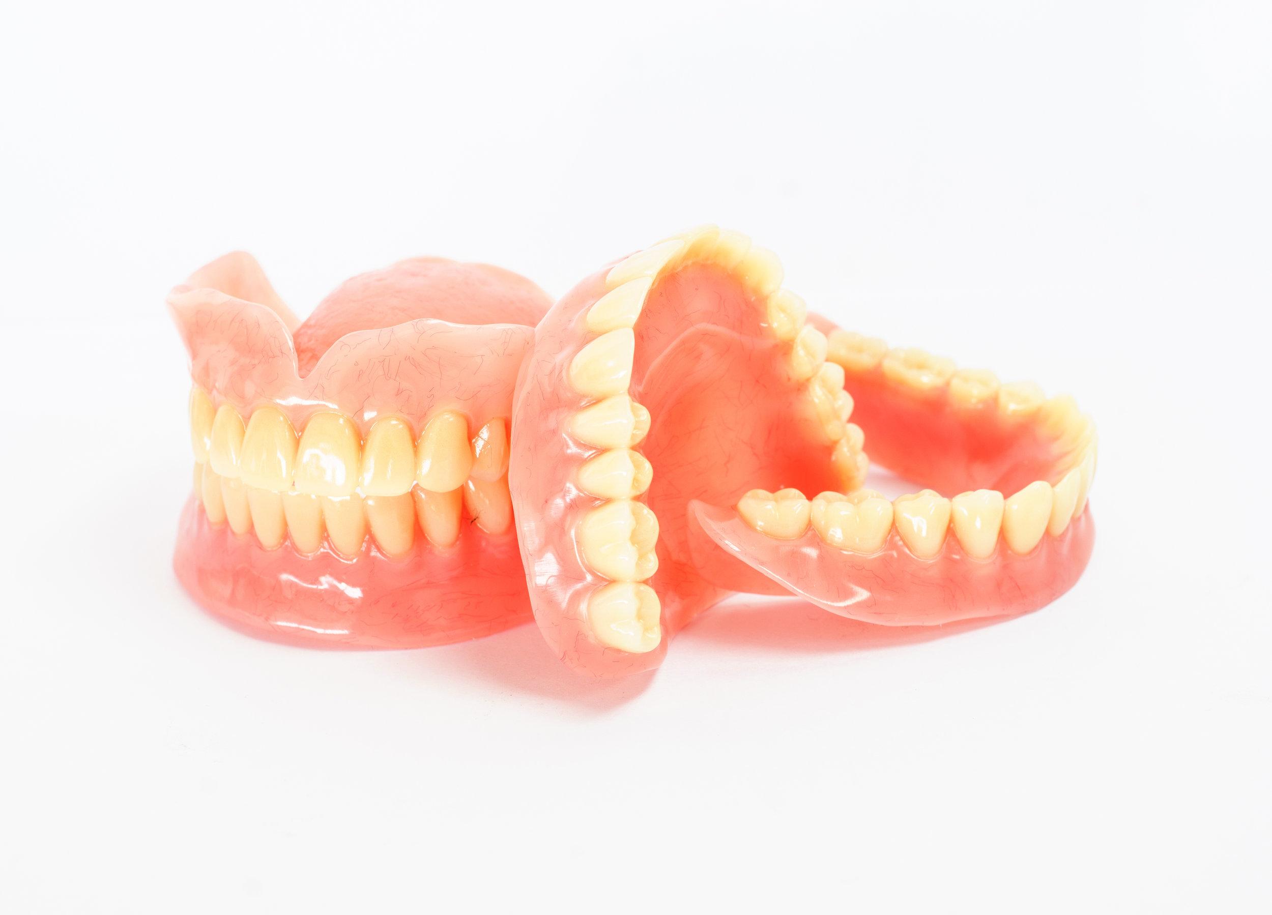 Canva - Full denture.jpg