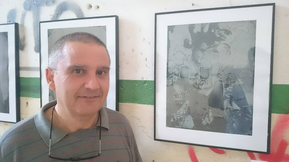 "My friend and REVELA-T volunteer, Jesus Joglar, beside my image ""Gathering Pieces"" in the Cal Garbat, Vilassar de Dalt."
