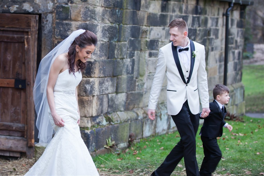 Bride, Mary Jane (MJ), taking care of her precious dress with groom, Adam. East Riddlesden Hall, Keighley, West Yorkshire.