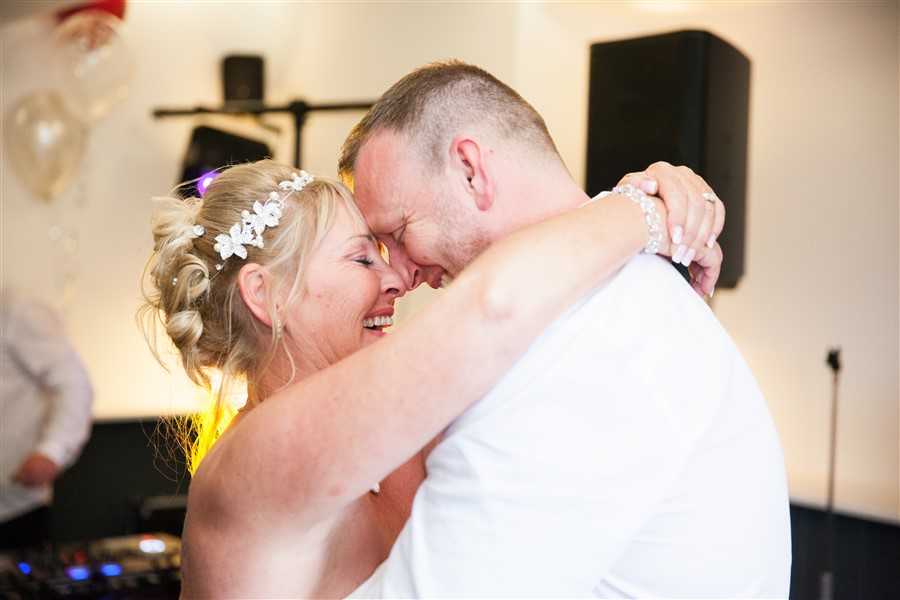 Evening photos provide a lighting challenge. But who would miss their first dance? Keighley, West Yorkshire.