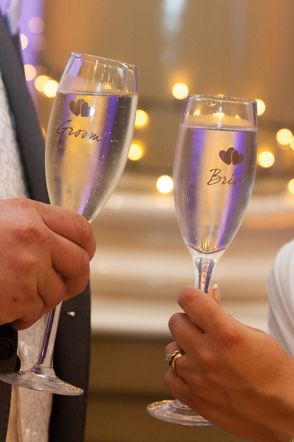 bride-and-groom-glasses-of-champagne.jpg