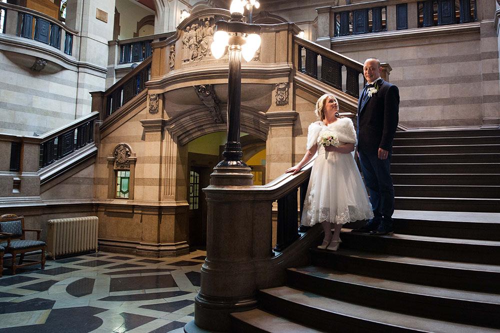 bride-and-groom-on-beautiful-staircase.jpg
