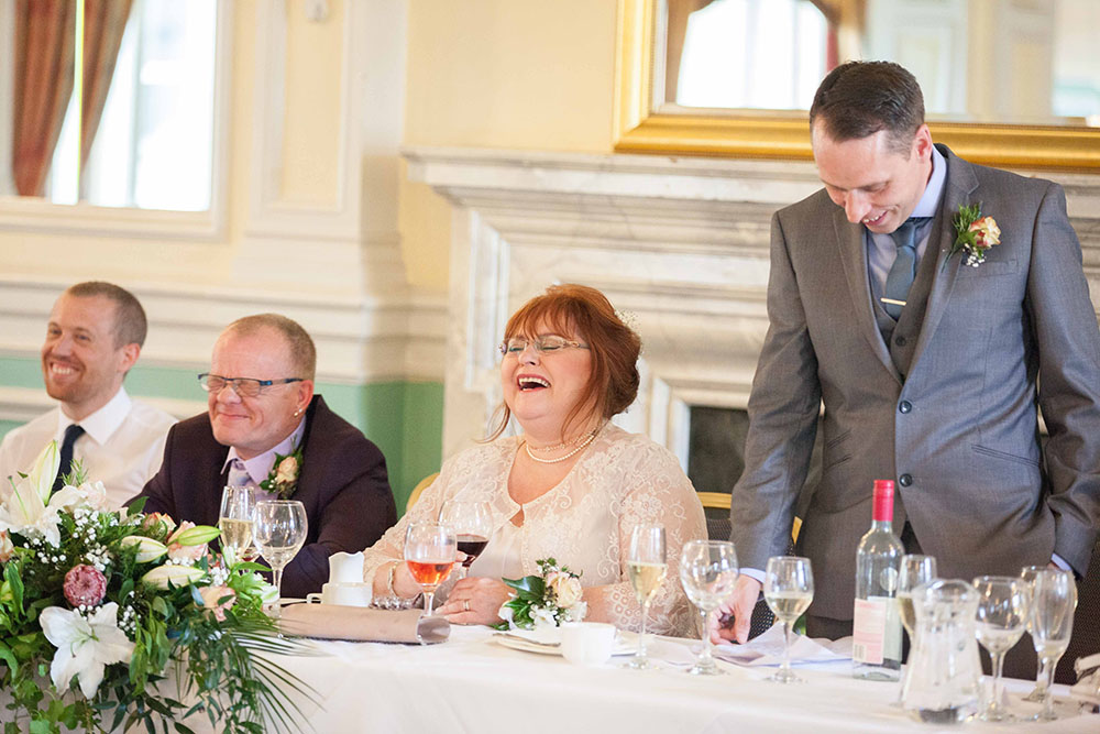 bride-laughing-at-best-man-speech-at-midland-hotel-bradford.jpg