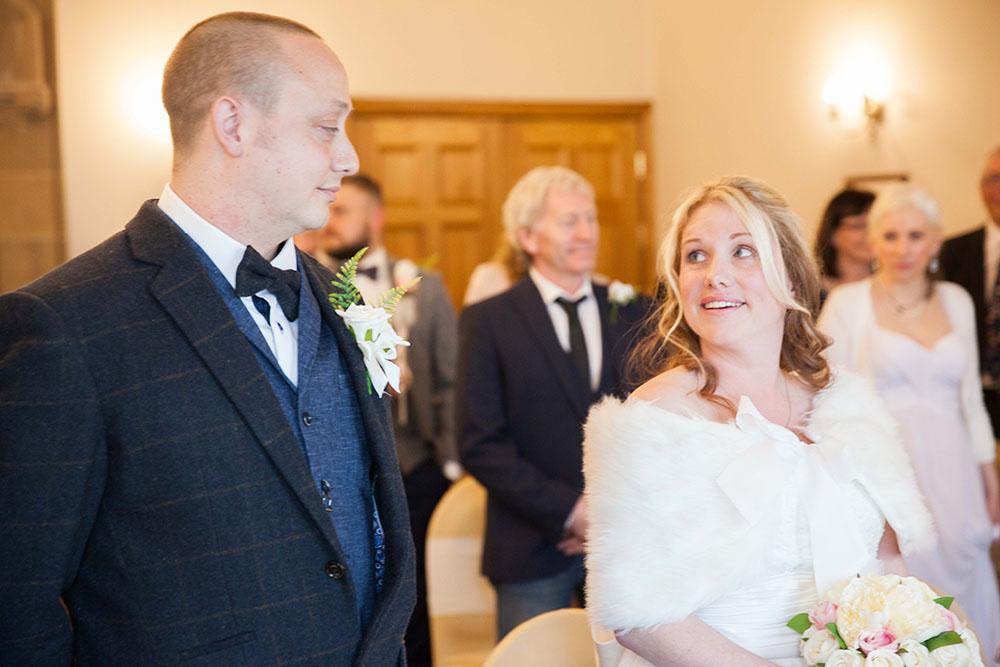 bride-looking-at-groom-intentively.jpg