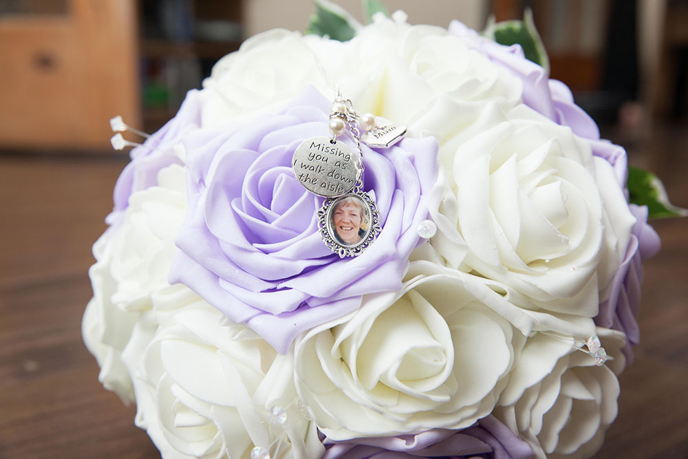 brides-bouquet-with-white-and-purple-flowers.jpg